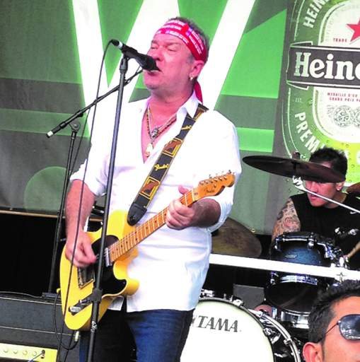 Singer Jimmy Barnes wore a campaign bandanna during a set.